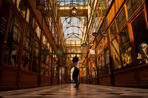 A women walking in the Passage du Grand Cerf shopping gallery.