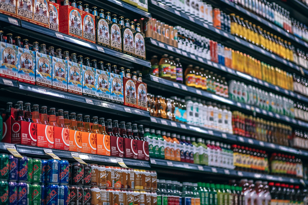 rows of beverages in a supermarket